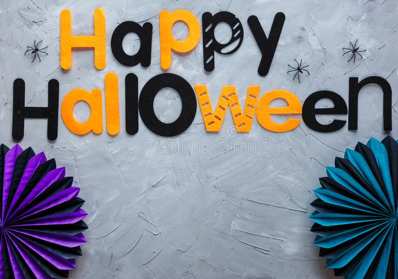 Title Happy Halloween on the gray background. Decoration, flat lay. Top view stock images