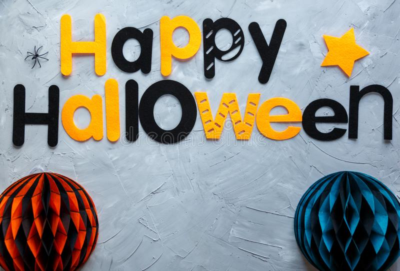 Title Happy Halloween on the gray background. Decoration, flat lay. Top view stock photos