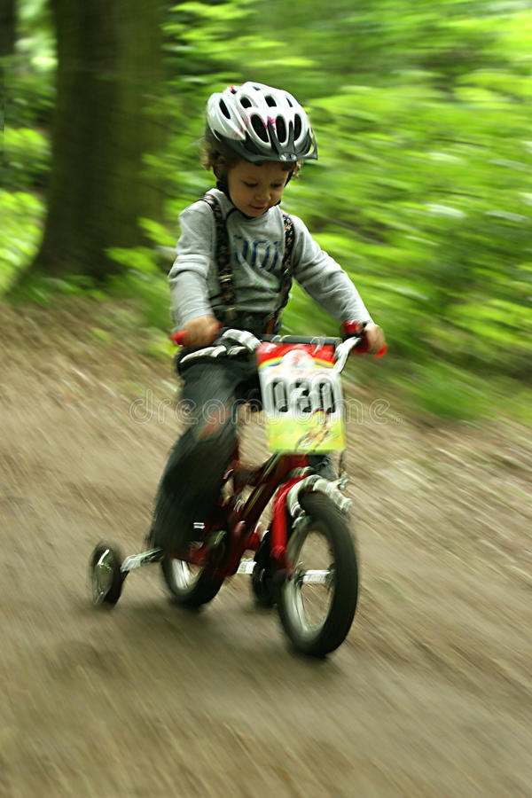 Tittle boy on the bike. UKRAINE, KIEV - MAY 30: Kozlenko Andriy with blurred background, at the child amateur bicycle competition We are the champions, on May stock photo