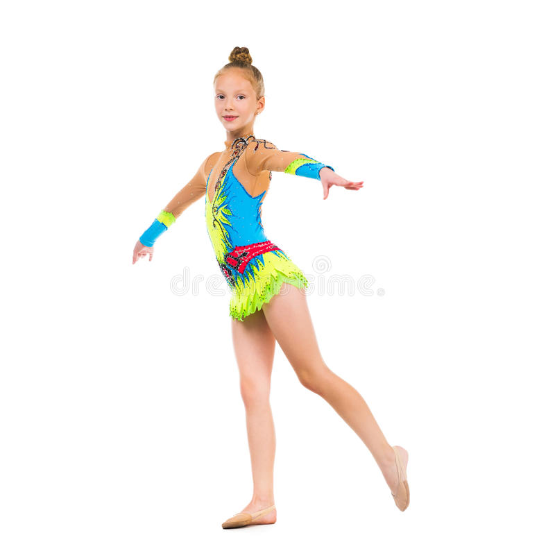 Tittle gymnast doing an exercise royalty free stock images