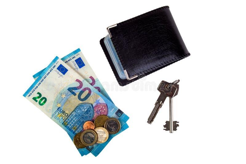Titular de tarjeta, dinero y llaves aislados en el fondo blanco foto de archivo libre de regalías