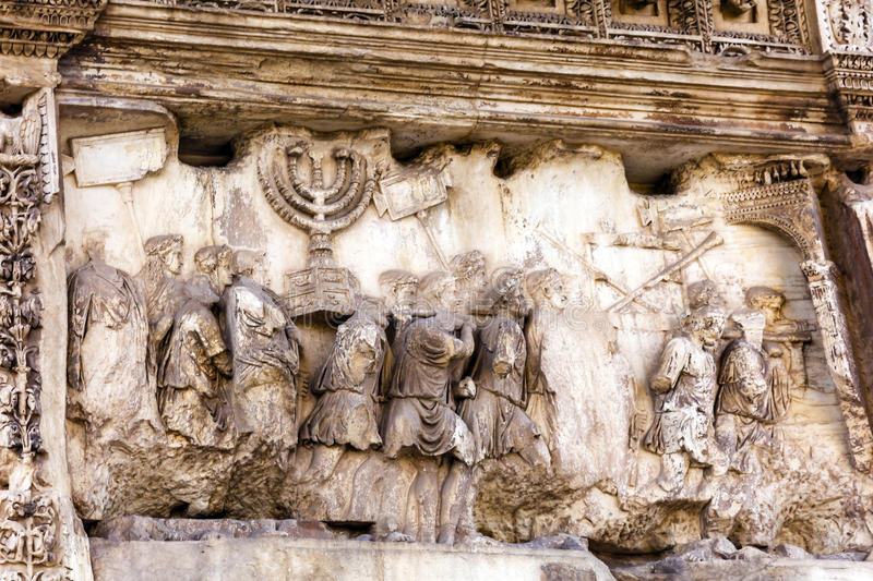 Titus Arch Roman Loot Jerusalem Temple Victory Forum Rome Italy. Titus Arch Roman Loot Menorah Temple Jerusalem Forum Rome Italy. Stone arch was erected in 81 AD royalty free stock photography