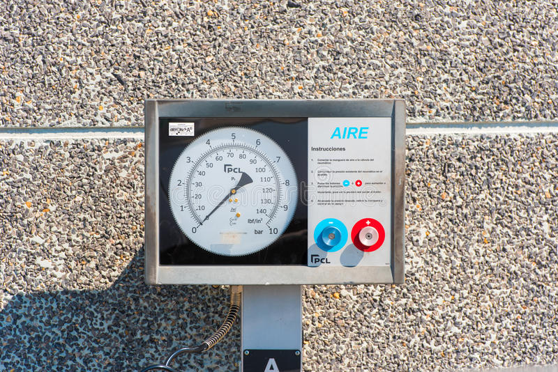 TIVISSA, TARRAGONA, SPAIN - MAY 31, 2017: The device for inflating tires. Pressure meter. Close-up. TIVISSA, TARRAGONA, SPAIN - MAY 31, 2017: The device for stock images