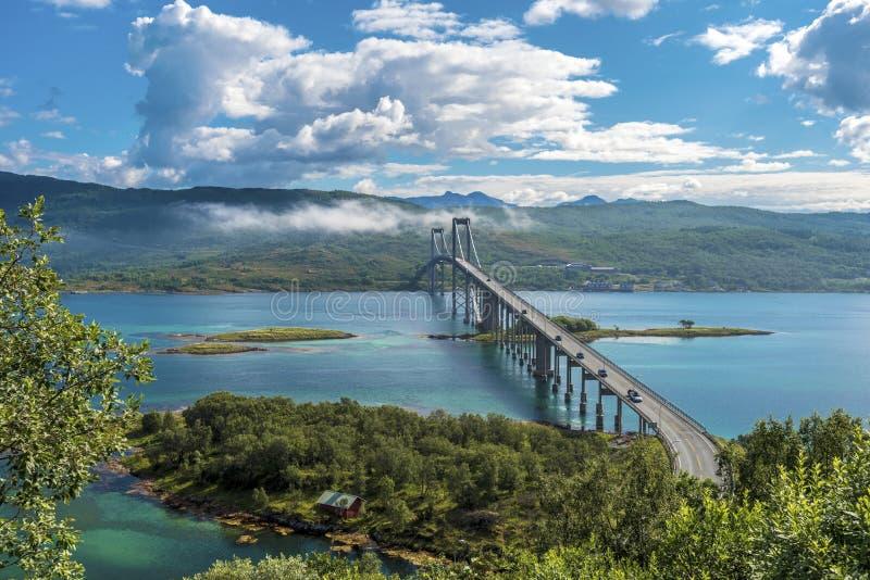 The Tjeldsund Bridge through Tjeldsundet strait viewed from Hinnoya Island, the mainland of Norwegian Troms county is at. Background stock photo