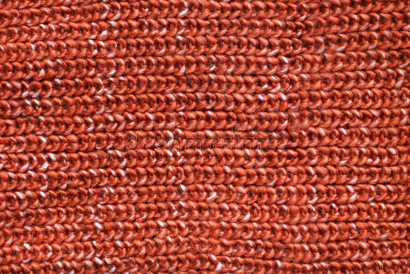 Tjock för rät maskatröja för orange kabel bakgrund för tyg royaltyfri foto