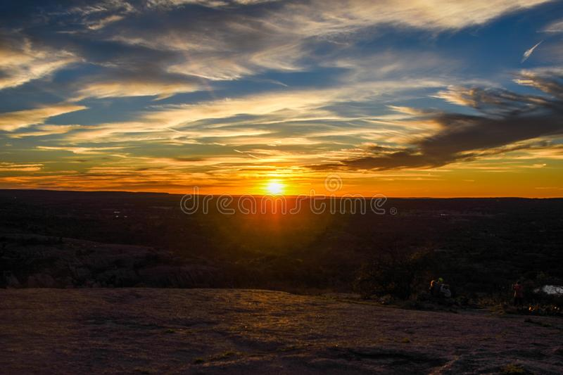 Tjusat vagga solnedgången arkivfoton