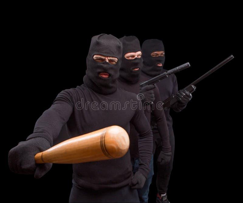 Tjuvar i maskeringar royaltyfria foton