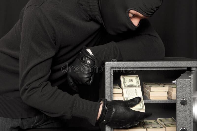 Tjuvinbrottstjuv och hemkassaskåp arkivfoton