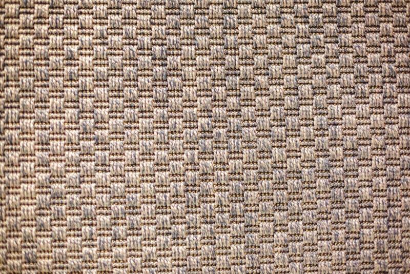 Tkanej tekstury beżowy dywanik, drelich zdjęcie stock