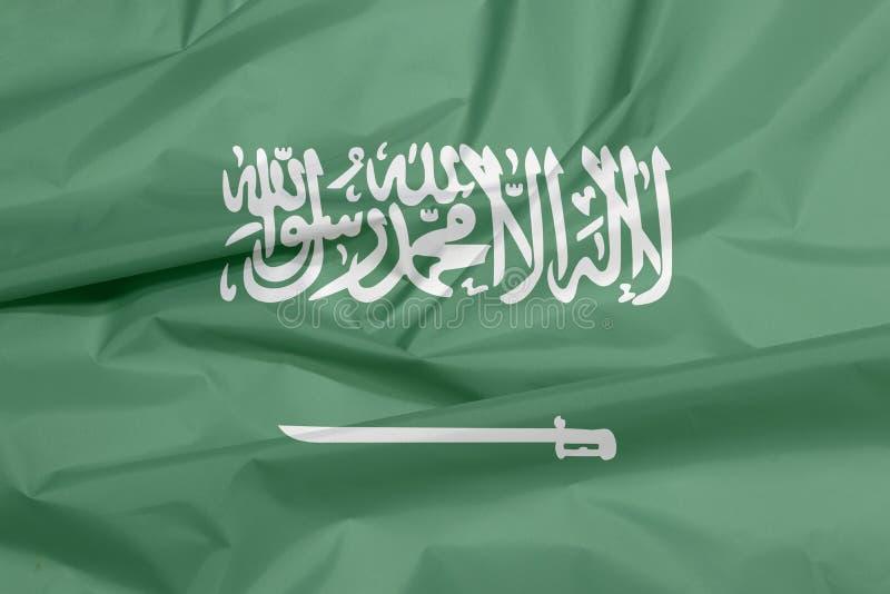 Tkaniny flaga Arabia Saudyjska Zagniecenie saudyjczyk - arabski chorągwiany tło fotografia stock