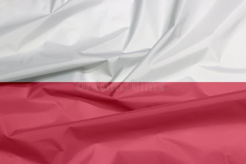 Tkaniny flaga Polska Zagniecenie połysk flaga tło obrazy stock
