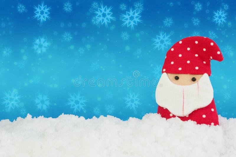 Tkaniny Santa lala na białym śniegu z abstrakcjonistycznym tłem obrazy stock