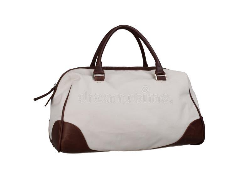 Tkaniny torebka z skór łatami na białym tle zdjęcia stock