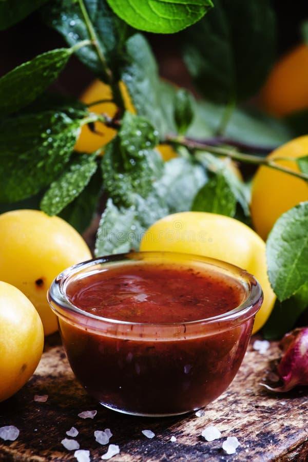 Tkemali Georgian cherry plum sauce, with garlic, vintage wooden stock photos
