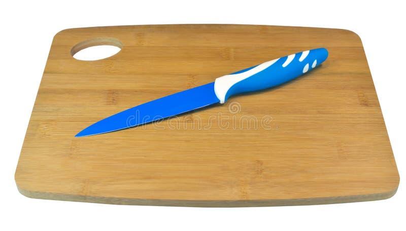 Tnąca deska i ceramiczny kuchenny nóż obrazy royalty free