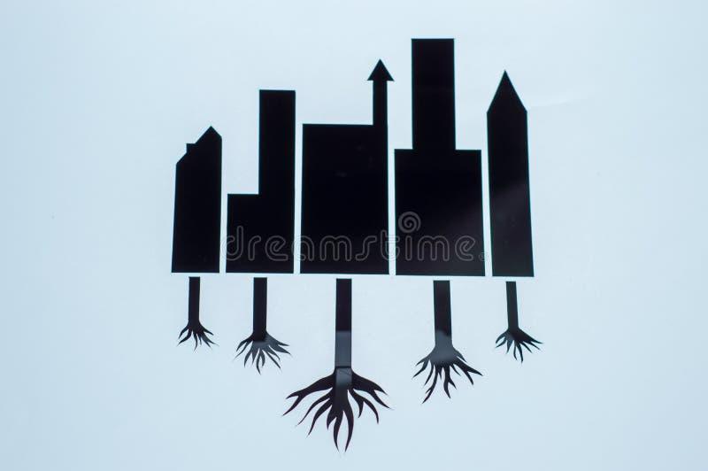 Tnąca papierowa ilustracja oprócz ziemi czarny budynek z korzeniem drzewa ilustracji