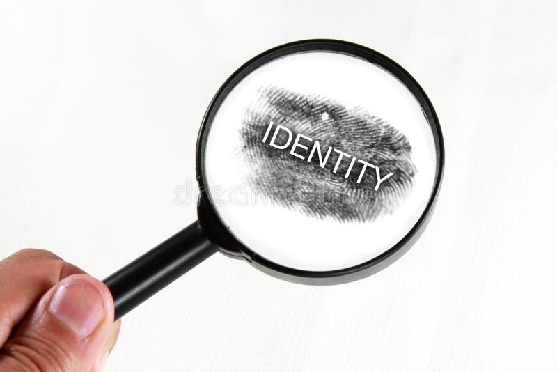 tożsamość powiększa obraz stock