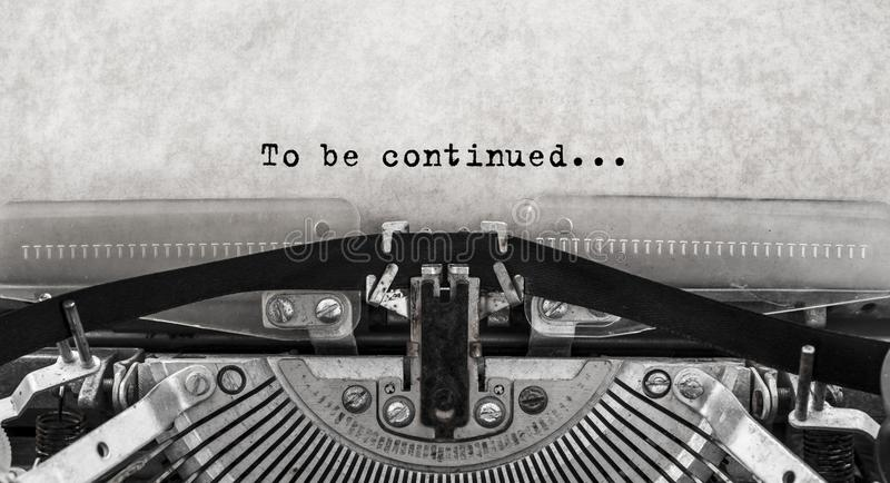 To be continued... typed words on a old Vintage Typewriter. Close up stock photo
