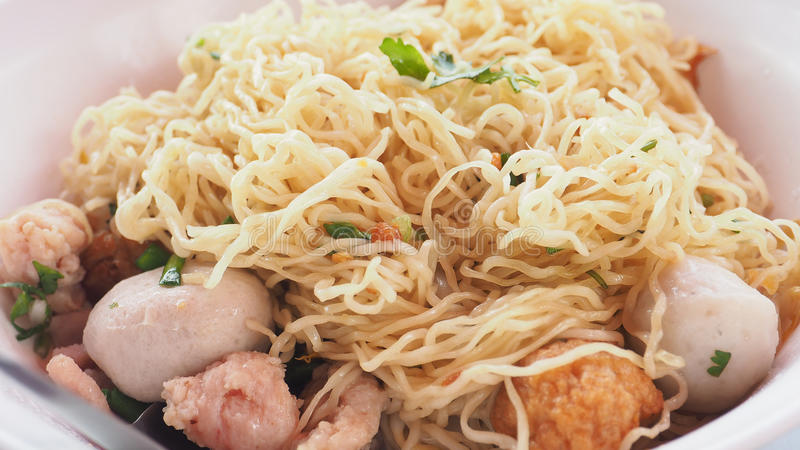 To clenching the egg noodle menu ready to eat photo extra close. Up see detail, Have fish and pork ball, parsley, green onions sliced, shrimp dumplings in white stock photos