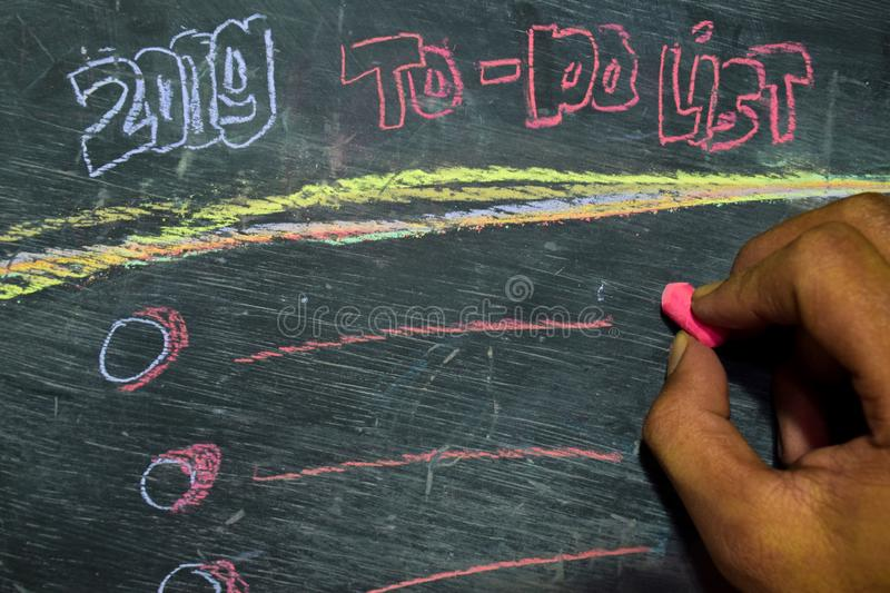 2019 To - Do List handwritten text with colorful chalk on blackboard background. Inspiration, education and celebration concepts royalty free stock image