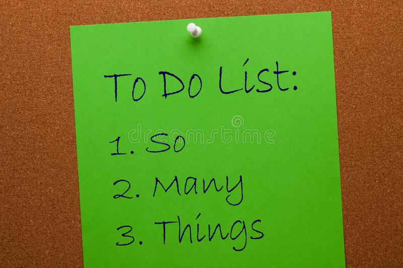 To Do List So Many Things. To Do List - So Many Things written on green paper sheet pinned on cork board. Business concept stock photography
