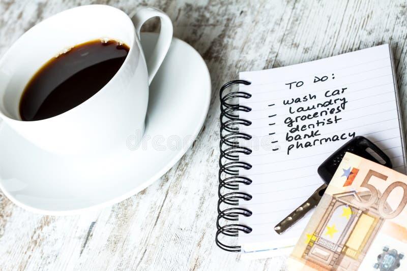 To do list. Meanwhile having a coffee stock photos
