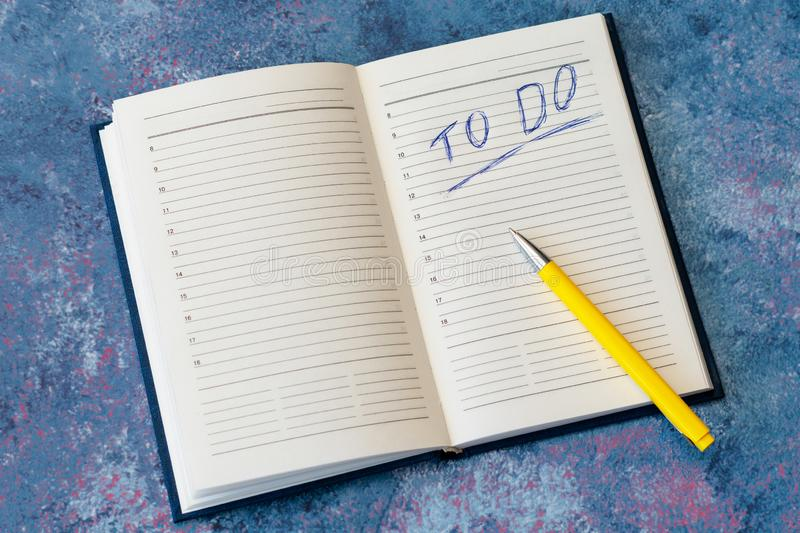 To do list in opened business notebook stock photos