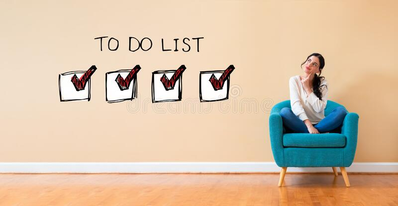 To do list with woman in a thoughtful pose royalty free stock photo