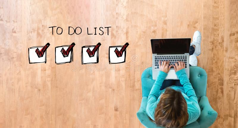 To do list with woman using laptop royalty free stock photo