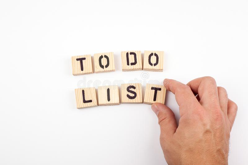 To do list. Wooden letters on a white background stock images