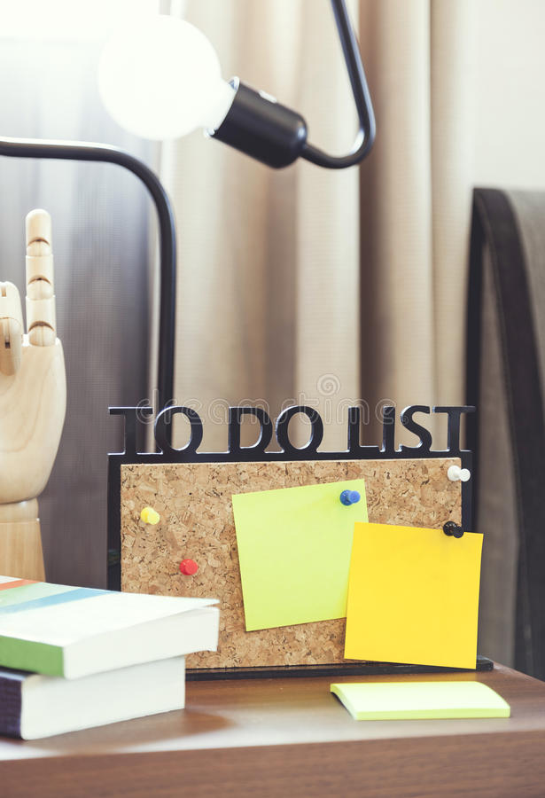 To do lists board with blank note. Office working table stock photos