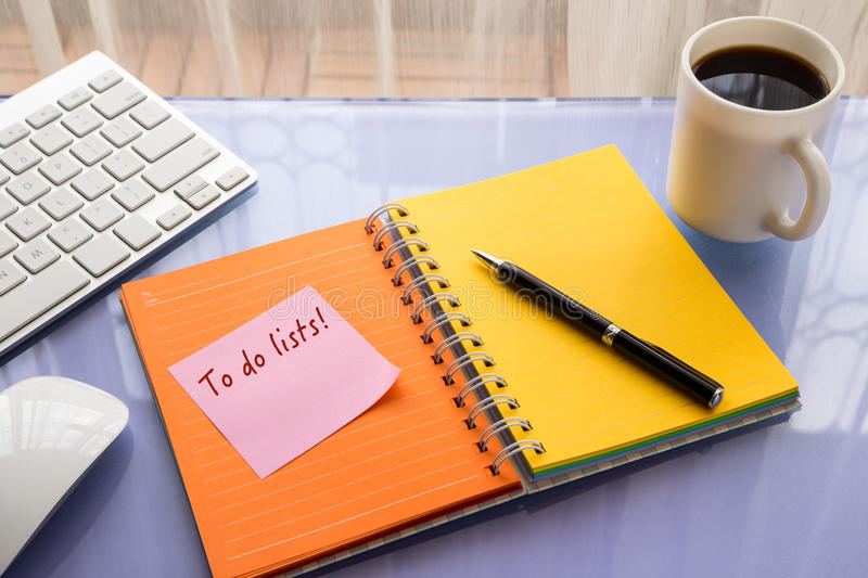 To do lists word on reminder notepad. To do lists word on note pad stick on blank colorful paper notebook at home office table, reminder concept royalty free stock photo