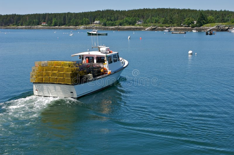 To the Dock. Lobster Boat headed to dock after hauling in the traps royalty free stock photo