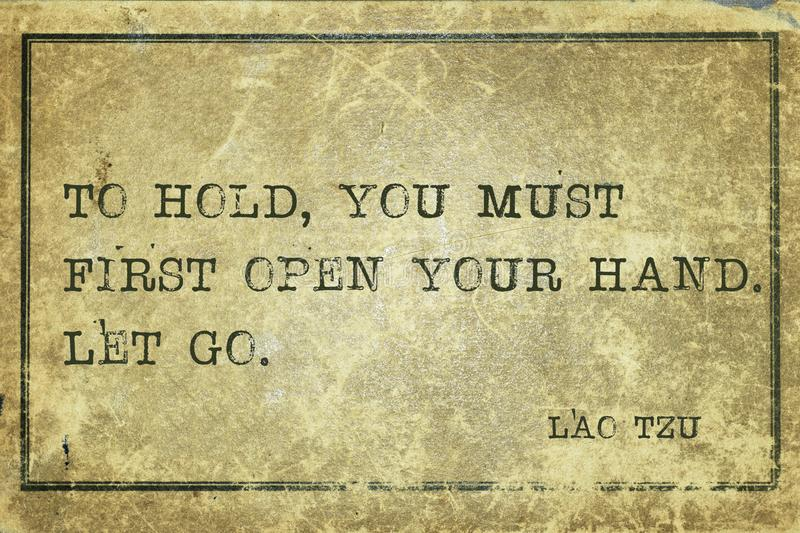 To hold LT. To hold, you must first open your hand - ancient Chinese philosopher Lao Tzu quote printed on grunge vintage cardboard royalty free illustration