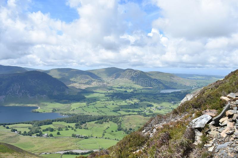 On mountainside looking over Loweswater, Lake District. To the left is Crummock Water over on the right is Loweswater, end of Melbreak in shadow on left also royalty free stock image