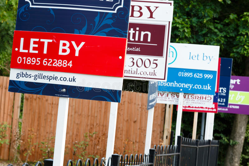 To let sign UK. Estate agent signs advertising property to let in UK