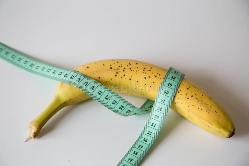 To lose a few inches. N order to lose weight you can sit on a fruit diet, count calories, thereby leaving extra inches on the wais stock photo