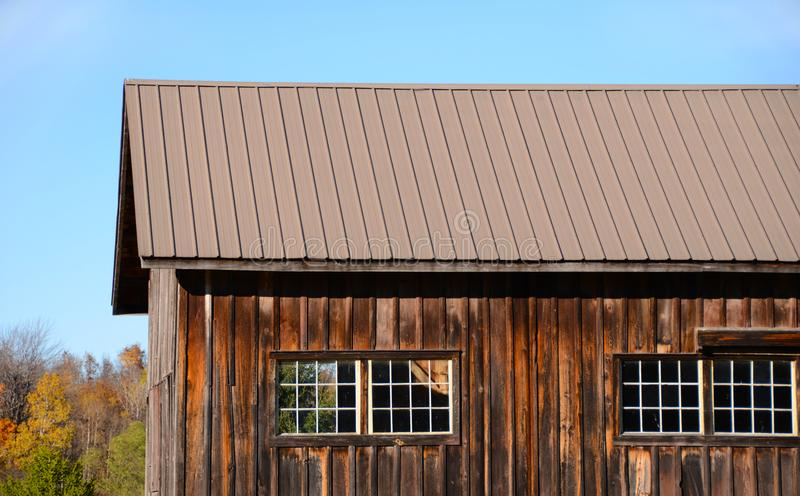 Board and batten vintage barn and windows. To preserve barns and buildings in olden days they were constructed with vertical boards to let rain run off flow more royalty free stock images
