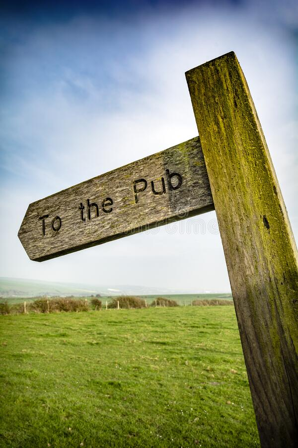 To the pub sign in rural English setting stock photo