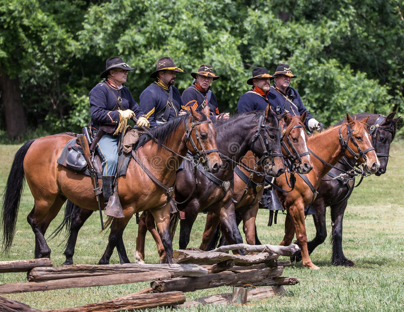 To the Rescue. Civil War era soldiers in battle at the Dog Island reenactment in Red Bluff, California stock image