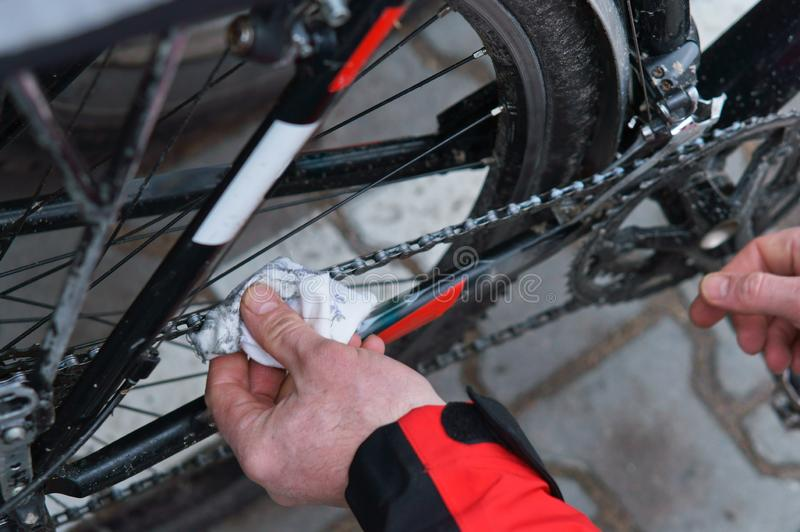 To take care of the bike, maintenance of the Bicycle, to lubricate parts and clean. To take care of the bike, to lubricate parts and clean, maintenance of the stock image