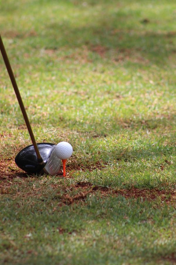 About to tee off. Getting ready to tee off at the tee box royalty free stock image