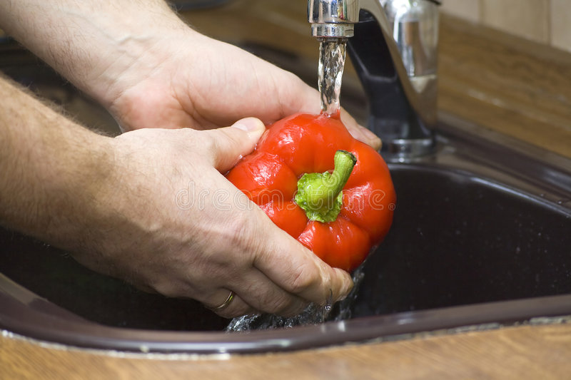 To wash up a pepper royalty free stock photos