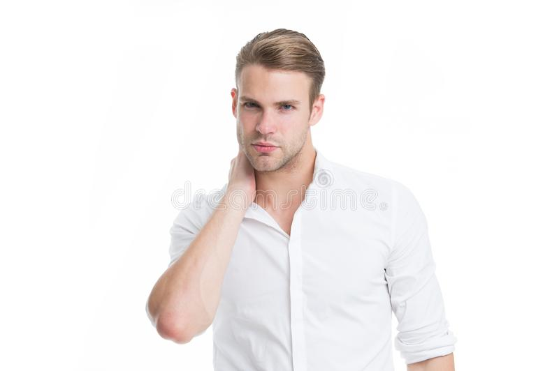 When to worry about neck pain. Neck pain causes symptoms and diagnosis. Man serious face touches neck white background. When to worry about neck pain. Neck pain royalty free stock photos