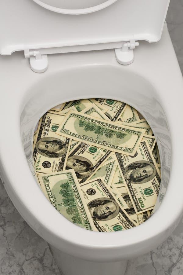 Toalete, dólares, um foto de stock