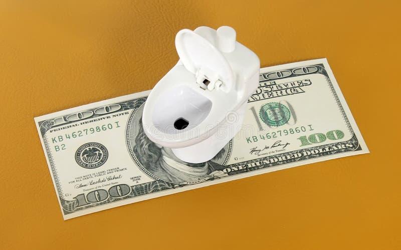 Toalete para o dinheiro imagens de stock