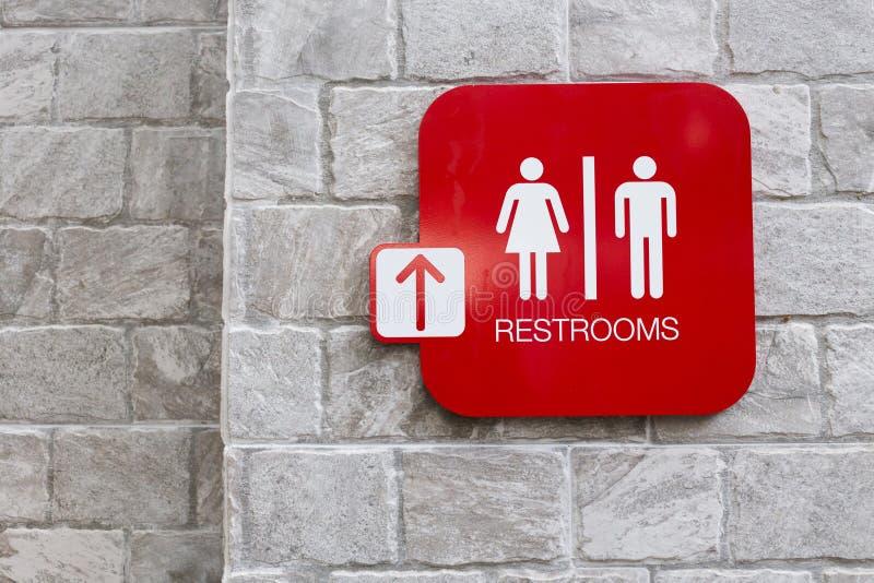 Toaletttecken med kvinnligt och manligt symbol royaltyfri bild