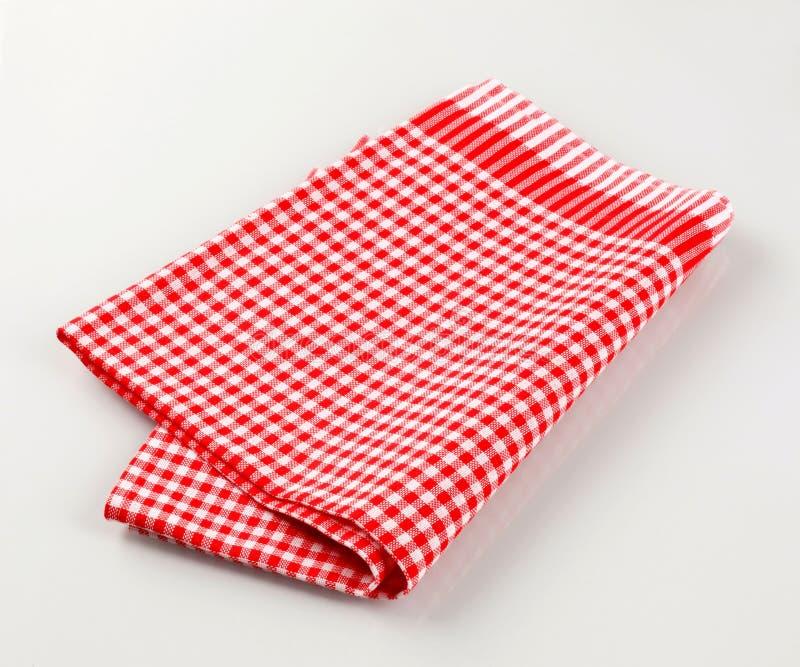 Toalha de chá vermelha e branca fotografia de stock