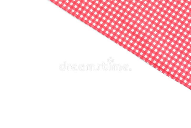 Toalha de mesa quadriculado vermelha clássica na vista branca, superior imagens de stock