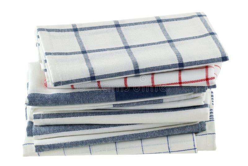 Toalhas de cozinha dobradas em testes padrões diferentes imagens de stock